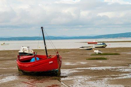empty red boat on beach