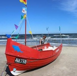 red rescue boat on beach