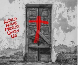 red cross daubed on old wooden door, writing on wall says Lord have mercy upon us, plague, quarantine, London 1665 pandemic,