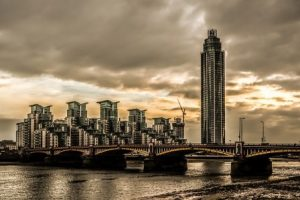 dark unoccupied tower blocks by  the River Thames in Vauxhall  London