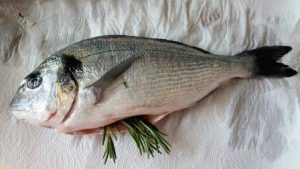 futted fish, stuffed with rosemary, ready to be cooked