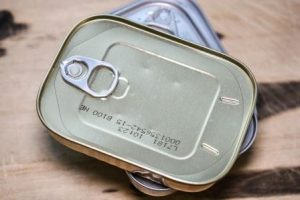 unlabelled tin can of fish with ring pull ready to be liftedhe li