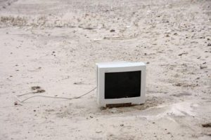 one computer monitor on a sandy beach