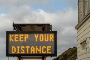 traffic sign saying Keep Your Distance, ego, stay away