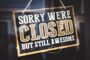 sign saying Sorry we're closed but still awesome, get a grip, see it as it actually is