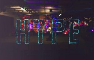 multicoloured neon sign saying hype