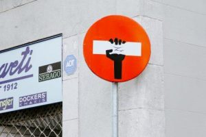traffic sign for no entry with hand crushing the white bar in the sign, yearn, crush nonsensical lockdowns and curfews