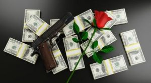 gun and red rose on top of dollar bills, attitude to money and wealth, USA guns, roses,